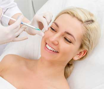 Dentist in Franklin, OH helps patients reduce facial wrinkles with dermal fillers and Botox injections
