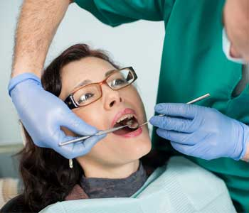 Doctor checking a girl's teeth
