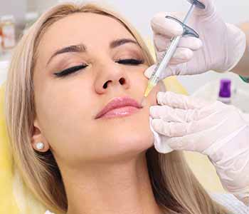 Doctor Injecting on girl's lip