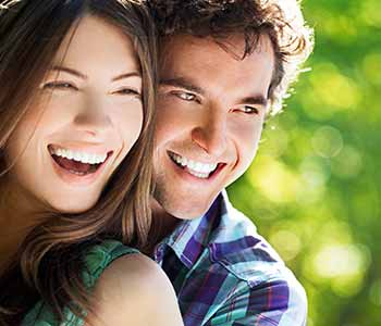 Smilling couple having bright teeth