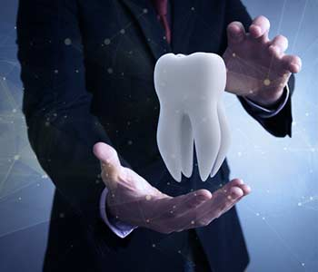 Dental insurance concept: businessman protecting a tooth with his hands